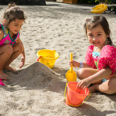 girls-playing-in-the-sand-400x400